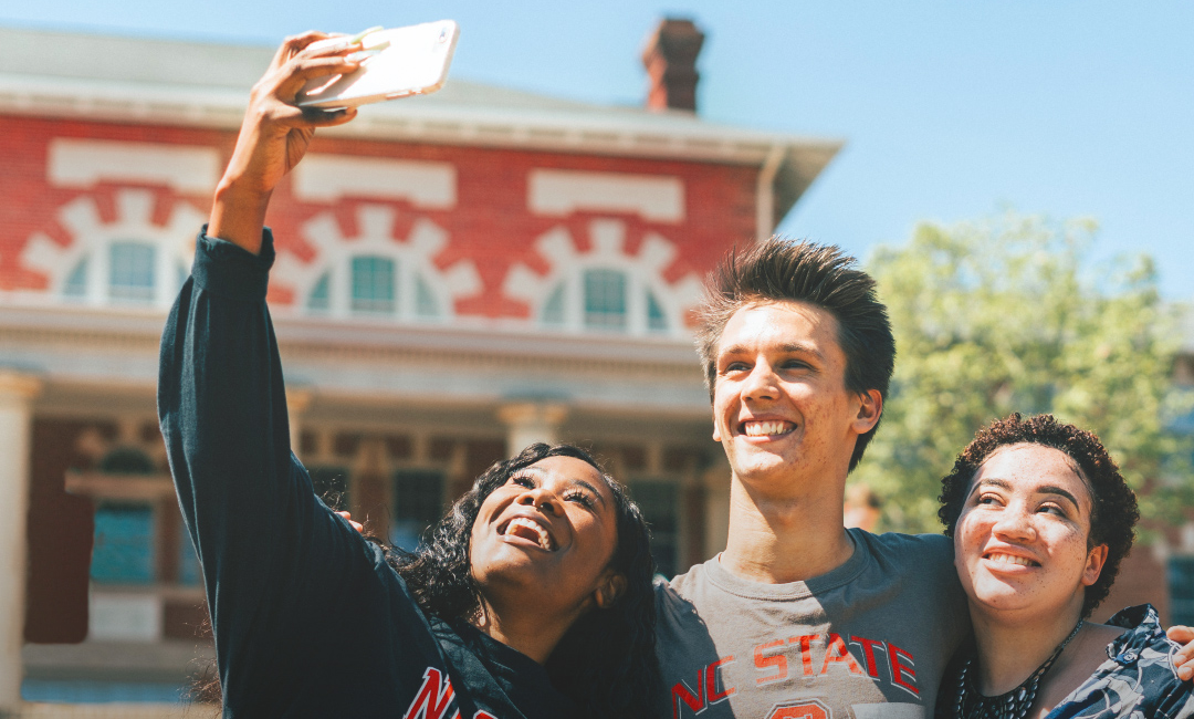 NC State students pose for a selfie
